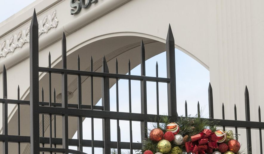 "FILE - This Thursday, Dec. 18, 2014 photo shows, holidays decorations on the Sony Pictures Studios front gates on the Overland Ave., entrance in Culver City, Calif. In an unprecedented move, Sony Pictures broadly released ""The Interview"" to digital platforms Wednesday, Dec. 24, 2014, a reversal of its previous plan not to show the film after hackers released thousands of documents online and threatened violence at theaters showing the comedy that depicts the assassination of North Korean leader Kim Jong Un.  (AP Photo/Damian Dovarganes)"