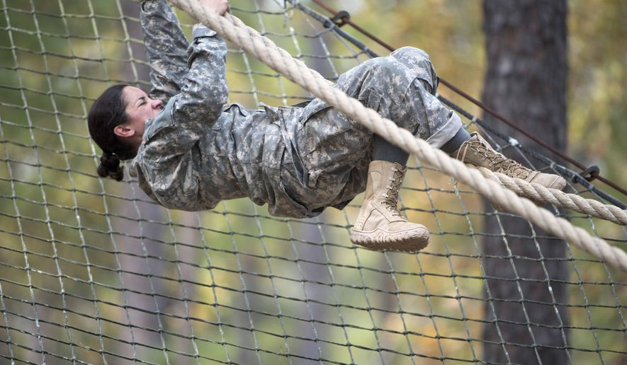 1st. Lt. Alessandra Kirby negotiating the Darby Obstacle Course at Fort Benning during the Ranger Assessment in this undated photo. (AP Photo/US Army, Patrick A. Albright) ** FILE **