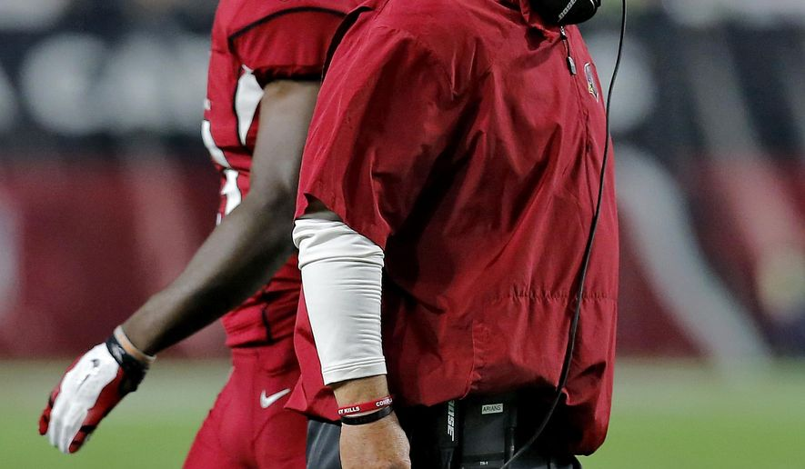 Arizona Cardinals head coach Bruce Arians yells during the first half of an NFL football game against the Seattle Seahawks, Sunday, Dec. 21, 2014, in Glendale, Ariz. (AP Photo/Rick Scuteri)