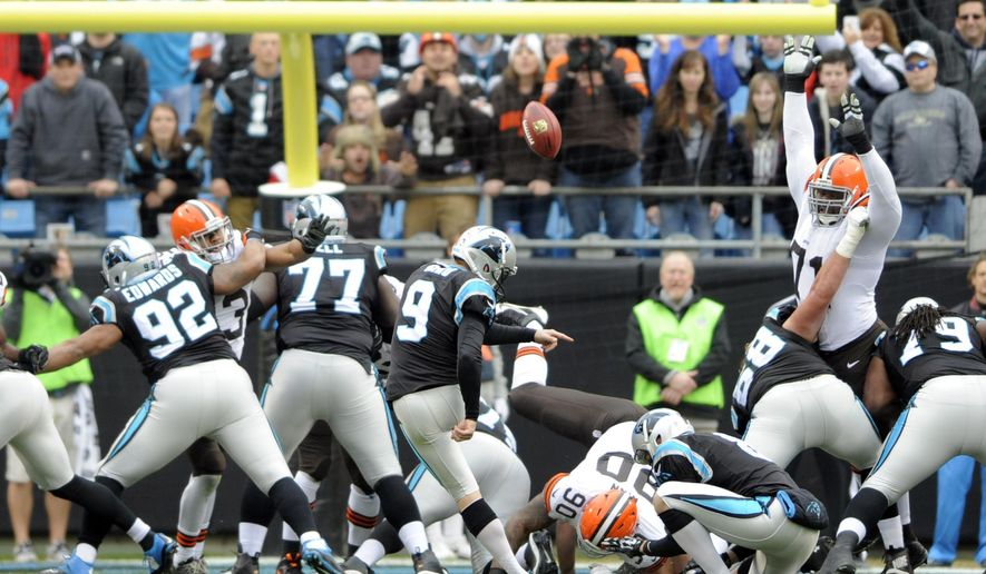 Carolina Panthers' Graham Gano (9) kicks a field goal against the Cleveland Browns in the first half of an NFL football game in Charlotte, N.C., Sunday, Dec. 21, 2014. (AP Photo/Mike McCarn)
