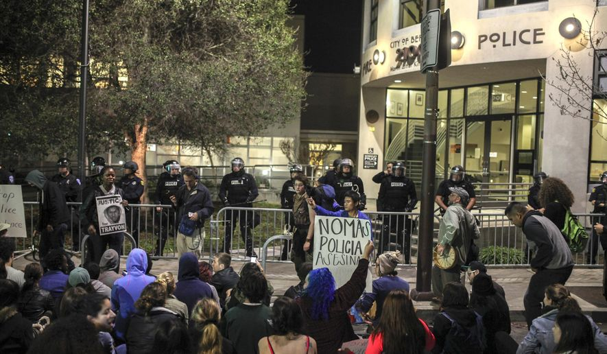 """FILE - This Dec. 6, 2014 file photo shows demonstrators protesting in front of the Berkeley police station in Berkeley Calif. The San Francisco Bay Area's three largest police unions publish an """"open letter"""" saying recent the anti-police rhetoric demonstrations have reached dangerous levels. (AP Photo/San Francisco Chronicle, Sam Wolson, file)"""