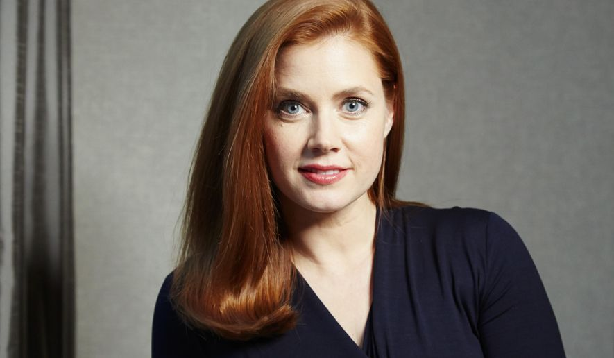 "In this Friday, Dec. 12, 2014 photo, actress Amy Adams poses for a portrait in promotion of her upcoming role in director Tim Burton's biopic film focused on Margaret Keane, ""Big Eyes,"" in New York. The movie releases in the U.S. Christmas Day, Dec. 25, 2014. (Photo by Dan Hallman/Invision/AP)"