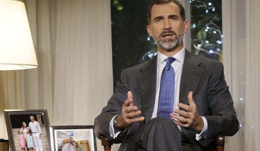 In this undated picture Spain's King Felipe VI gives an speech at the Zarzuela Palce, near Madrid. The speech watched by millions on TV is the most important national address by Spanish kings and is a chance for Felipe to show his style as king six months after his father Juan Carlos abdicated and tell the nation what he thinks about the state of the economically hurting country and what Spaniards must do to improve it. (AP Photo/Angel Diaz, Pool)