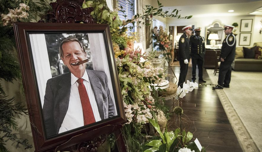 A portrait of former Houston Mayor Robert C. Lanier is displayed in the foyer at George H. Lewis & Sons Funeral Home before his funeral services on Tuesday, Dec. 23, 2014, in Houston. Lanier, who served as Houston's mayor from 1992-1998, died at his home of natural causes on Saturday. He was 89. (AP Photo/ Houston Chronicle,  Brett Coomer) MANDATORY CREDIT