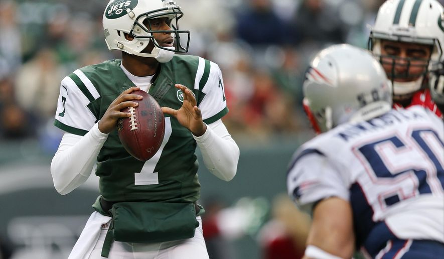 FILE - In this Dec. 21, 2014, file photo, New York Jets quarterback Geno Smith looks to throw a pass during the first half of an NFL football game against the New England Patriots in East Rutherford, N.J. Smith will be under center for the New York Jets' season finale at Miami on Sunday, in perhaps his last start with the franchise. After two shaky seasons, the Jets are likely to pursue a quarterback either through free agency or the draft this offseason. (AP Photo/Julio Cortez, File)