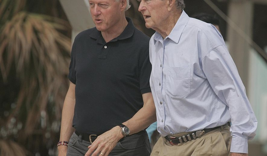 FILE - In this Oct. 14, 2008 file photo, former Presidents Bill Clinton and George Bush walk on the beach in Galveston, Texas. Again? Really? There are more than 300 million people in America, yet the same two families keep popping up when it comes to picking a president. The possibility of a Bush-Clinton matchup in 2016 is increasingly plausible. After months of hints and speculation, former Florida Gov. Jeb Bush last week said he's actively exploring a bid for the Republican nomination. And while Hillary Rodham Clinton hasn't revealed her intentions, she's seen as the odds-on favorite for the Democratic nomination. (AP Photo/Pat Sullivan, File)