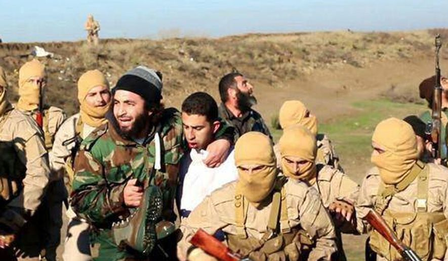 This image posted by the Raqqa Media Center, which monitors events in territory controlled by Islamic State militants with the permission of the extremist group, shows militants with a captured pilot, center, wearing a white shirt in Raqqa, Syria, Wednesday, Dec. 24, 2014. Islamic State group militants captured a Jordanian pilot, Mu'ath Safi Yousef al-Kaseasbeh, after his warplane went down in Syria, Jordan said Wednesday, the first such capture since the international coalition's air campaign against the group began. The pilot's family confirmed that it is al-Kaseasbeh shown in the image. (AP Photo/Raqqa Media Center)