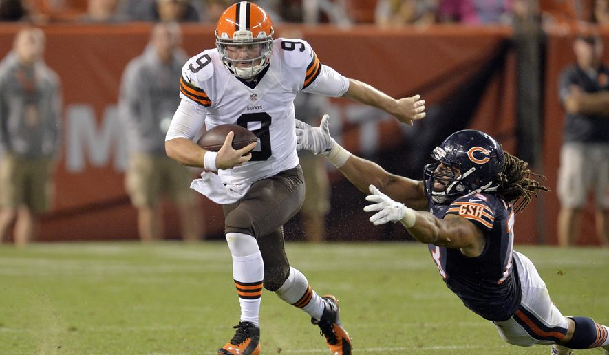 FILE - In this Aug. 28, 2014, file photo, Cleveland Browns quarterback Connor Shaw (9) runs away from Chicago Bears defensive end Austen Lane in the fourth quarter of a  preseason NFL football game in Cleveland. With both Brian Hoyer and Johnny Manziel out with injuries, the rookie quarterback is expected to make his first NFL start Sunday against a Baltimore Ravens team fighting for a playoff spot. (AP Photo/David Richard, File)