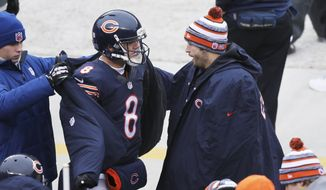 Chicago Bears' Jay Cutler, right, talks to starting quarterback Jimmy Clausen (8) on the bench in the first half of an NFL football game against the Detroit Lions Sunday, Dec. 21, 2014, in Chicago. (AP Photo/Charles Rex Arbogast)