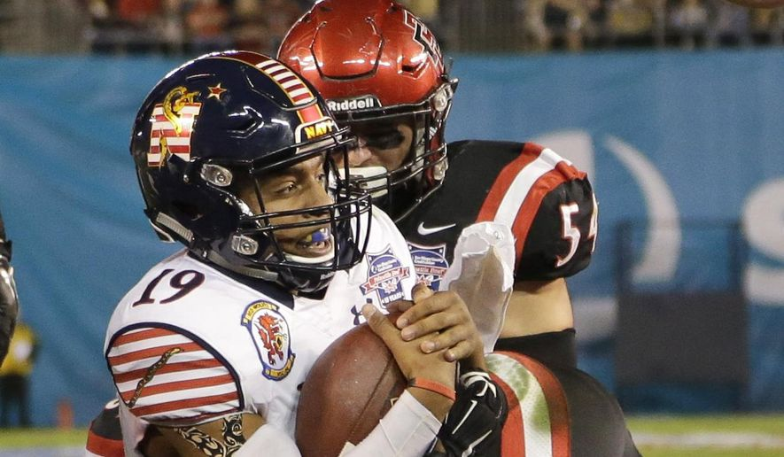 Navy quarterback Keenan Reynolds scores a touchdown against San Diego State during the first half of the Poinsettia Bowl NCAA college football game Tuesday, Dec. 23, 2014, in San Diego. (AP Photo/Gregory Bull)