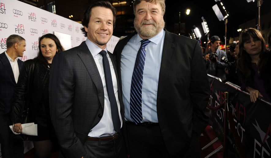 """FILE --In this Nov. 10, 2014 file photo, Mark Wahlberg, left, star and producer of """"The Gambler,"""" poses with fellow cast member John Goodman at the premiere of the film at AFI Fest 2014, in Los Angeles. The film releases in the U.S. on Christmas Day, Dec. 25, 2014. (Photo by Chris Pizzello/Invision/AP, File)"""