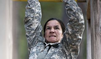 In this undated photo released by the Utah National Guard, 1st. Lt. Alessandra Kirby negotiates the Darby Obstacle Course at Fort Benning during the Ranger Assessment. Kirby, a Utah National Guard soldier will be among a handful of women going to the grueling Army Ranger school as part of the U.S. military's first steps toward allowing women to move into the elite combat unit. (AP Photo/US Army, Patrick A. Albright) ** FILE **