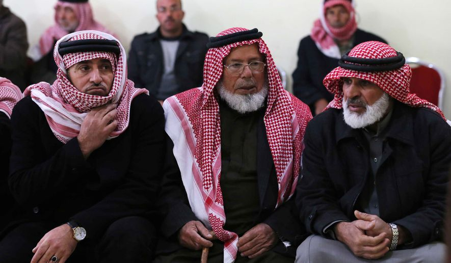 Friends and relatives of Mu'ath Safi al-Kaseasbeh, a Jordanian pilot captured by the Islamic State group, gather in the town of Aey near Al Karak in southern Jordan, Wednesday, Dec. 24, 2014. Islamic State militants captured the Jordanian pilot after his warplane crashed in Syria while conducting airstrikes Wednesday, the first foreign military member to fall into the extremists' hands since an international coalition launched its bombing campaign against the group months ago. (AP Photo/Raad Adayleh)
