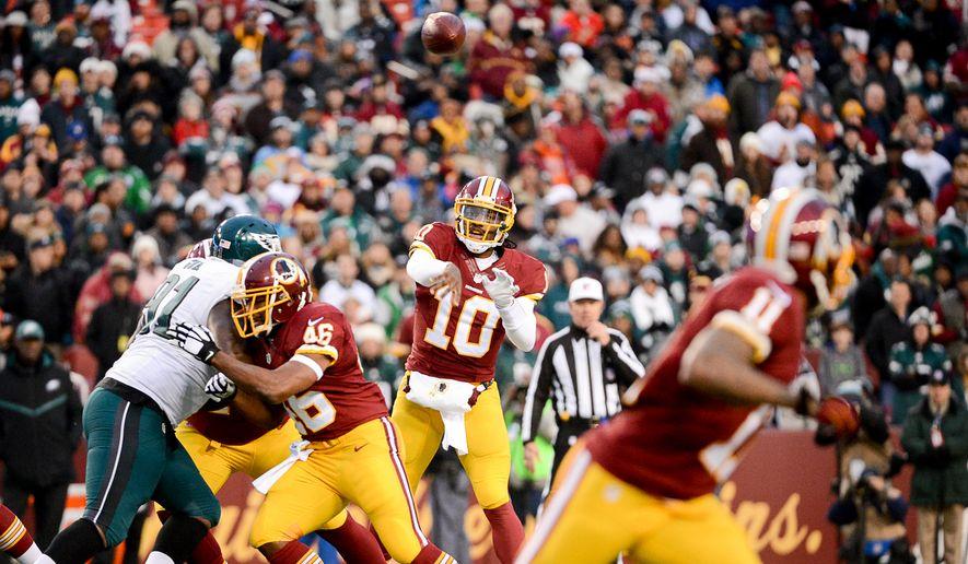 Washington Redskins quarterback Robert Griffin III (10) passes to Washington Redskins wide receiver DeSean Jackson (11) in the first quarter as the Washington Redskins play the Philadelphia Eagles at FedEx Field, Landover, Md., Saturday, December 20, 2014. (Andrew Harnik/The Washington Times)