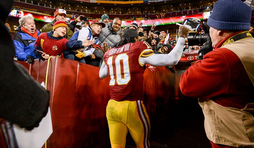 Washington Redskins quarterback Robert Griffin III (10) leaves the field after the Washington Redskins defeat the Philadelphia Eagles 27-24 at FedExField, Landover, Md., Saturday, December 20, 2014. (Andrew Harnik/The Washington Times)