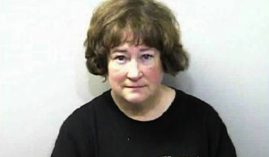 Susan Hemeryck, 54, was arrested Tuesday morning after police say she tore apart a Satanic Temple holiday display in the Florida Capitol lobby. (Leon County Sheriff's Office via The Tallahassee Democrat)
