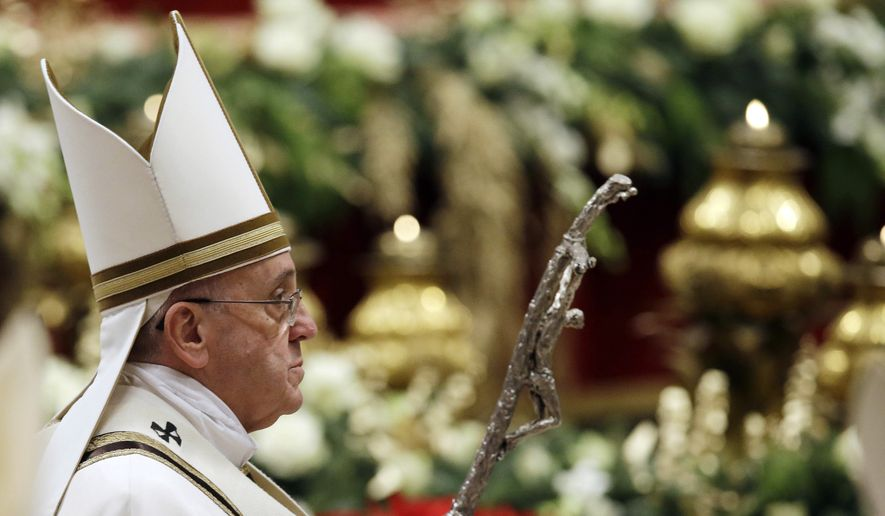 Pope Francis leaves after celebrating the Christmas Eve Mass in St. Peter's Basilica at the Vatican, Wednesday, Dec. 24, 2014. (AP Photo/Gregorio Borgia) ** FILE **