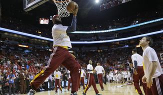 Cleveland Cavaliers forward LeBron James warms up before an NBA basketball game against the Miami Heat, Thursday, Dec. 25, 2014, in Miami. (AP Photo/Lynne Sladky)