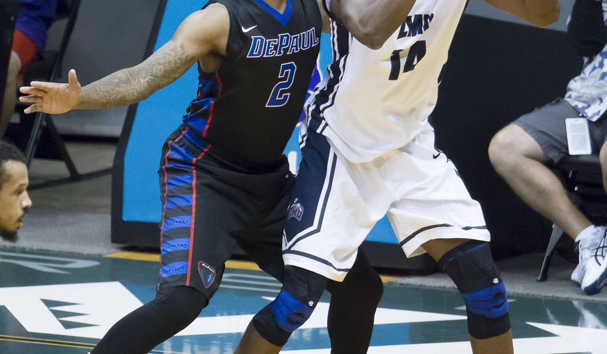 Loyola Marymount forward Patson Siame, right, looks for an open teammate to pass to while bend defended by DePaul center Tommy Hamilton IV (2) in the first half of an NCAA college basketball game at the Diamond Head Classic on Thursday, Dec. 25, 2014, in Honolulu. (AP Photo/Eugene Tanner)