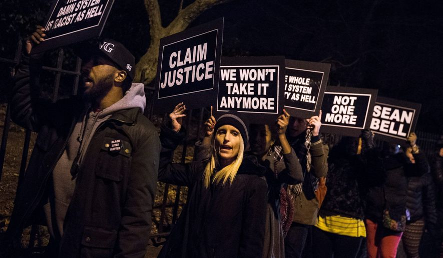 Protesters chant as they rally outside Gracie Mansion in New York City on Dec. 15.