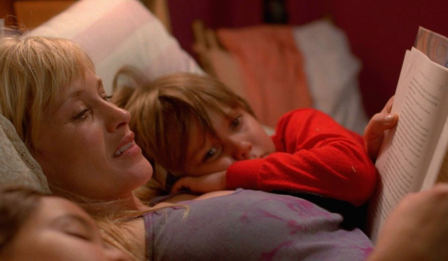 """Patricia Arquette and Ellar Coltrane star in """"Boyhood,"""" a coming-of-age story and a triumph of accessible experimental cinema. (Associated Press)"""