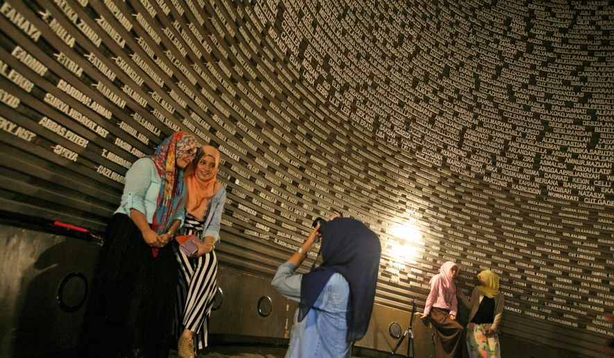 Acehnese women visit the Tsunami Museum in Banda Aceh, Indonesia, the worst-hit region of the 2004 tsunami. (Associated Press)