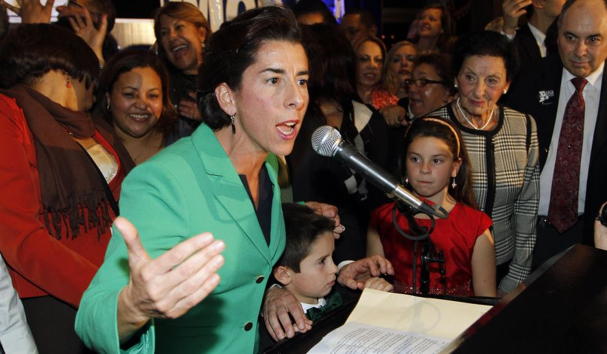 FILE - In this Nov. 4, 2014 photograph, Democrat Gina Raimondo celebrates her win over Republican Allan Fung in the Rhode Island governor's race in Providence, R.I. The most expensive governor's race in Rhode Island history and a Statehouse raid that led to the fall from power of House Speaker Gordon Fox topped the news in Rhode Island in 2014. (AP Photo/Stew Milne, File)