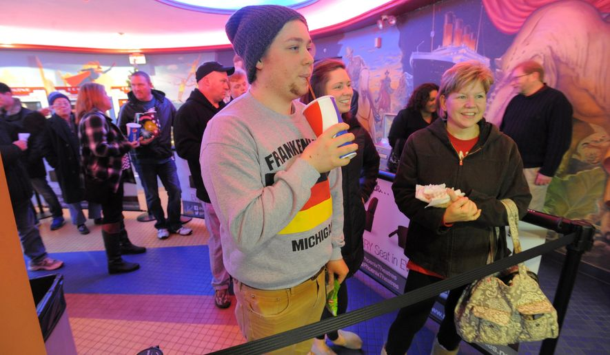 "Cody Borg, of Wayne waits in line with his sister Danielle and mother Michelle, prior to the showing of ""The Interview"" at State Wayne Phoenix Theater, on Christmas, Thursday, Dec. 25, 2014.  The film's Christmas Day release was canceled by Sony after threats of violence by hackers linked to North Korea, but the release was reinstated in some independent theaters and through a variety of digital platforms. (AP Photo/Detroit News, Steve Perez)  DETROIT FREE PRESS OUT; HUFFINGTON POST OUT"