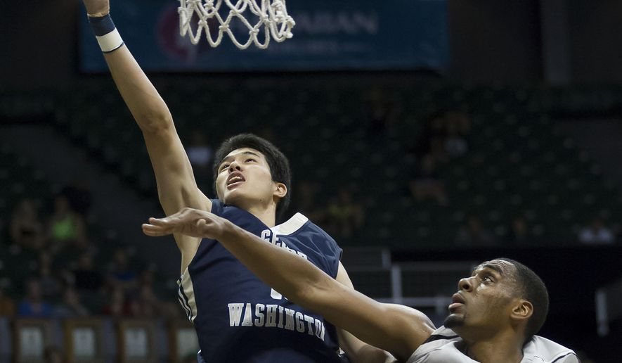 George Washington forward Yuta Watanabe, top left, shoots a layup while being defended by Wichita State forward Darius Carter (12) in the first half of an NCAA college basketball game at the Diamond Head Classic on Thursday, Dec. 25, 2014, in Honolulu. (AP Photo/Eugene Tanner)