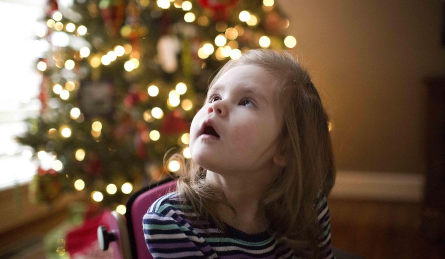 """Carly Chandler, 3, looks towards a window, Monday, Dec. 22, 2014, in Hoover, Ala. Chandler was diagnosed around her first birthday with CDKL5, a rare genetic disorder which causes severe neurodevelopmental impairment and is characterized by frequent seizures. """"Carly's Law,"""" signed into law by Gov. Robert Bentley nine months ago, funded a University of Alabama at Birmingham to study the marijuana derivative cannabidiol, or CBD oil, to treat severe seizures. (AP Photo/Brynn Anderson)"""