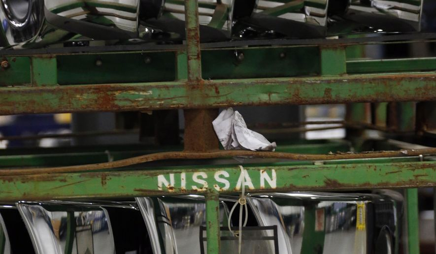 In this Dec. 12, 2014 photograph, a stack of bumpers await shipment to Nissan Motors' nearby assembly plant, at the automaker's 1.5-million-square-foot integrated logistics center in Canton, Miss. Nissan is focusing on improving its parts supply as it works to increase production capacity at its Mississippi plant. (AP Photo/Rogelio V. Solis)