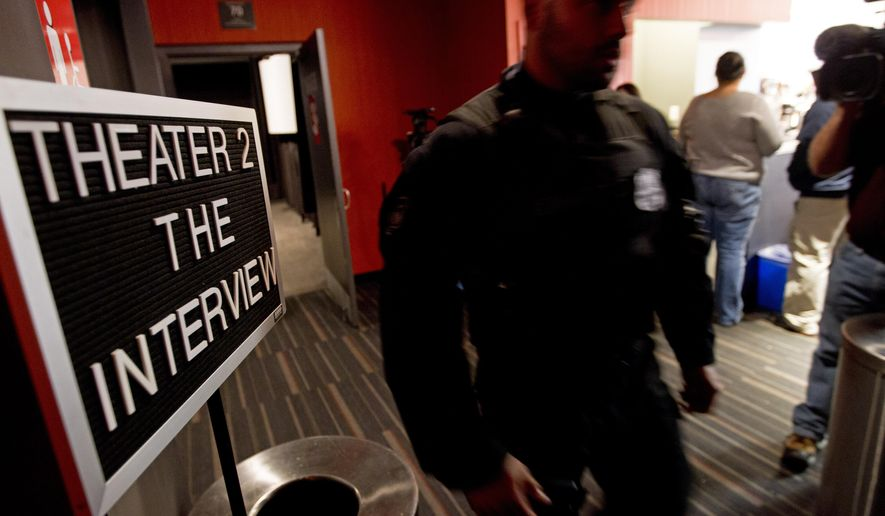FILE photo | A police officer keeps watch as moviegoers enter the theater to watch The Interview at West End Cinema in Washington, Thursday, Dec. 25, 2014. (AP Photo/Jose Luis Magana)