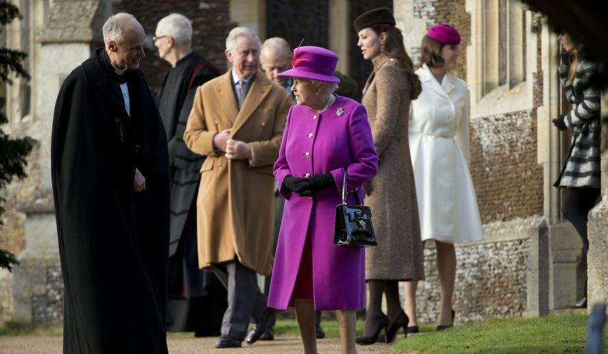 Britain's Queen Elizabeth II, center, her son Prince Charles, center left, and Kate Duchess of Cambridge, center right, leave after attending the British royal family's traditional Christmas Day church service at St. Mary Magdalene Church in Sandringham, England, Thursday, Dec. 25, 2014.  (AP Photo/Matt Dunham)