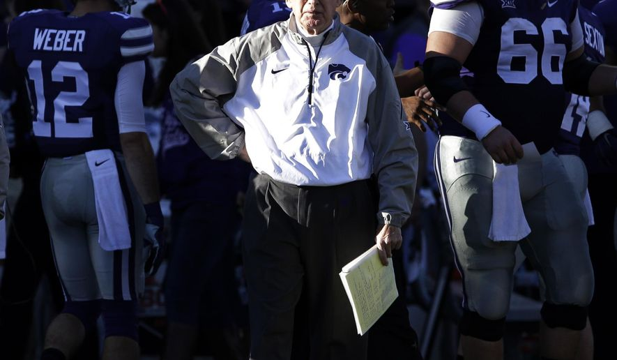 FILE - In this Nov. 29, 2014, file photo, Kansas State head coach Bill Snyder paces the sidelines during the first half of an NCAA college football game against Kansas in Manhattan, Kan. In an era of Twitter and text message, the old-school notes that coach Snyder sends out to opponents after every game stand out. (AP Photo/Orlin Wagner, File)