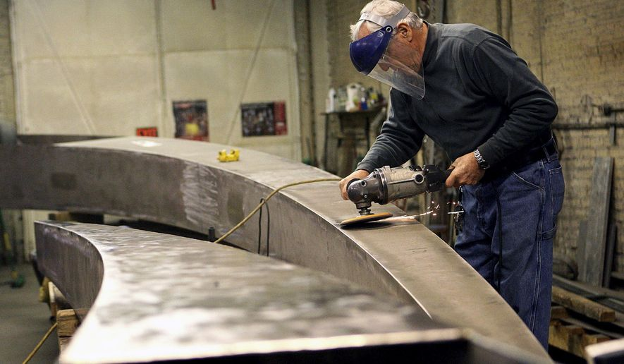 In this Nov. 19, 2014 photo, sculptor Bruce White works on a 40-foot steel sculpture for Marshalltown, Iowa in his DeKalb, Ill., studio. Now in his 80s, White seems to be as busy as ever, with recent large-scale public commission projects in Peoria; Marshalltown, Iowa; and Chattanooga, Tenn. (AP Photo/Daily Chronicle, Danielle Guerra)  MANDATORY CREDIT