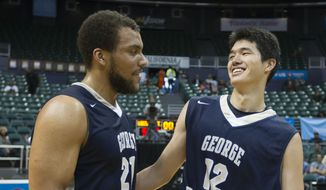 George Washington forward Kevin Larsen (21) and teammate Yuta Watanabe (12) enjoy the winning moment after a recent game. (AP Photo/Eugene Tanner) **FILE**