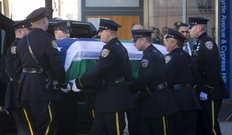 New York City police officers carry the casket of New York Police Department officer Rafael Ramos at his wake at Christ Tabernacle Church, in the Glendale section of Queens, where he was a member, Friday, Dec. 26, 2014, in New York.  Ramos was killed Dec. 20 along with his partner, Officer Wenjian Liu, as they sat in their patrol car in Brooklyn. The shooter, Ismaaiyl Brinsley, later killed himself. (AP Photo/John Minchillo)