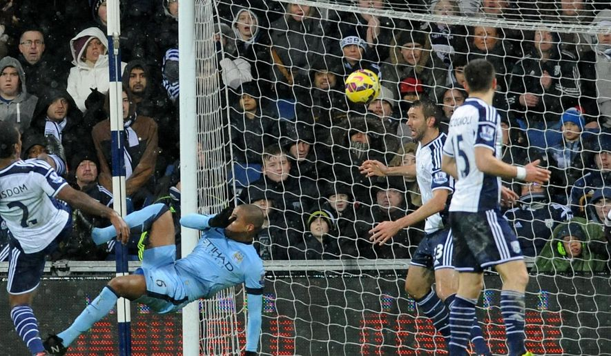 Manchester City's Fernando, second left, scores against West Brom during the English Premier League soccer match between West Bromwich Albion and Manchester City at the Hawthorns, Birmingham, England, Friday, Dec. 26, 2014. (AP Photo/Rui Vieira)