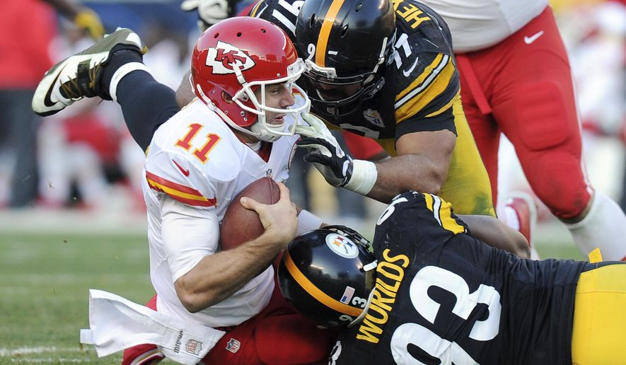FILE - In this Dec. 21, 2014, file photo, Kansas City Chiefs quarterback Alex Smith (11) is sacked by Pittsburgh Steelers defensive end Cameron Heyward (97) and  outside linebacker Jason Worilds (93) during the second half of an NFL football game in Pittsburgh. Smith will miss Sunday's game against the San Diego Chargers because of a lacerated spleen. Chase Daniel will start in his place. (AP Photo/Don Wright, File)