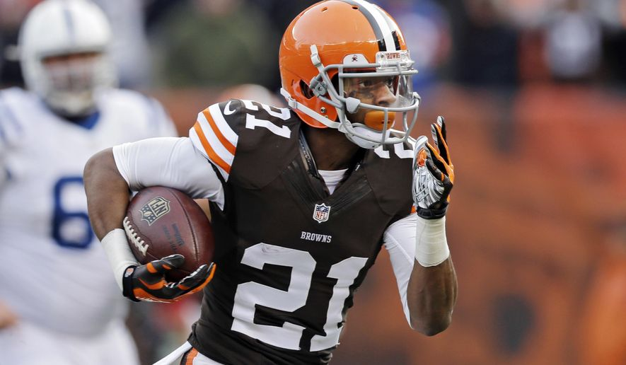 FILE - In this Dec. 7, 2014, file photo, Cleveland Browns cornerback Justin Gilbert returns an interception for a touchdown against the Indianapolis Colts in the third quarter of an NFL football game in Cleveland. Gilbert says he was hurt by public comments from some teammates who said he wasted this season. In the past week, safety Donte Whitner and Karlos Dansby were critical of Gilbert, saying he needed to grow up as a player and person. (AP Photo/Tony Dejak, File)
