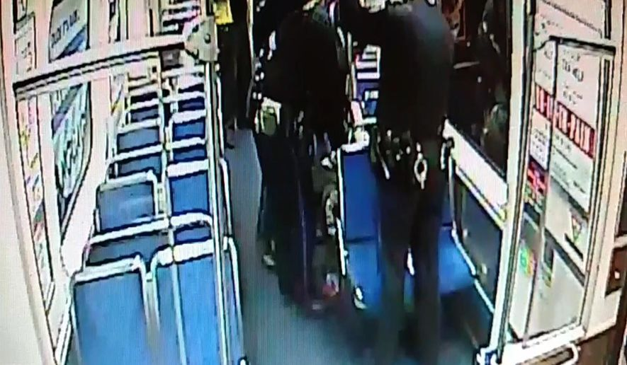 In this image from surveillance video provided by the Southeastern Pennsylvania Transportation Authority (SEPTA), two Philadelphia transit police officers, center and right, help deliver a baby boy on Thursday, Dec. 25, 2014, aboard a subway train at the 15th and Market streets station in Philadelphia. The mother and newborn were taken to Hahnemann University Hospital, where they were reported in good condition. (AP Photo/SEPTA)
