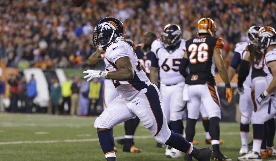 Denver Broncos running back C.J. Anderson (22) reacts following a 1-yard touchdown run during the second half of an NFL football game against the Cincinnati Bengals on Monday, Dec. 22, 2014, in Cincinnati. (AP Photo/Michael Conroy)