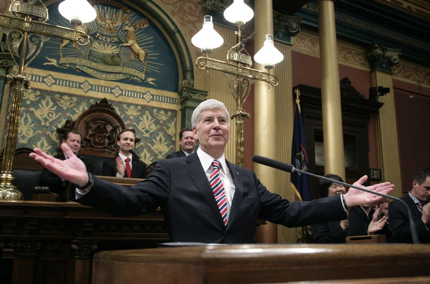 Michigan Gov. Rick Snyder is introduced before delivering his State of the State address to a joint session of the House and Senate in the House Chambers of the state Capitol in Lansing, Mich., on Jan. 16, 2014. (Associated Press)