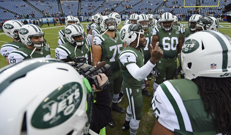 CORRECTS ID TO MICHAEL VICK (1), NOT GENO SMITH (7) FILE - In this Dec. 14, 2014, file photo, New York Jets quarterback Michael Vick (1) talks to his teammates before an NFL football game against the Tennessee Titans in Nashville, Tenn. QB Geno Smith will be under center for the Jets' season finale at Miami on Sunday, in perhaps his last start with the franchise. After two shaky seasons, the Jets are likely to pursue a quarterback either through free agency or the draft this offseason. (AP Photo/Mark Zaleski, File)