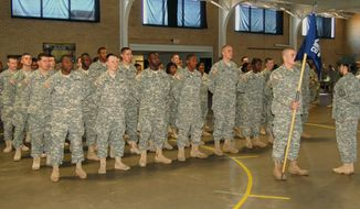 In this Dec. 13, 2014 photo made available by the South Carolina National Guard,  National Guard graduates attend a ceremony on Dec. 13, 2014, at the Guard armory in Columbia, S.C.  The soldiers are taking part in a ceremony to mark their graduation from the Recruit Sustainment Program, which follows new soldiers from their entry through their training and their placement in a special Guard unit. (AP Photo/South Carolina National Guard, Reagan Meetze)