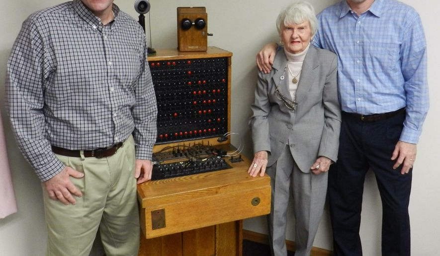 In this Dec. 18, 2014 photo, Marjorie Becker, is flanked by her two grandsons, Jason, left, and Jim Becker, in Middleburgh, N.Y. At the age of 92, Becker still looks forward to going to work each day at her company, the Middleburgh Telephone Co. (AP Photo/Oneonta Daily Star, Joe Mahoney)