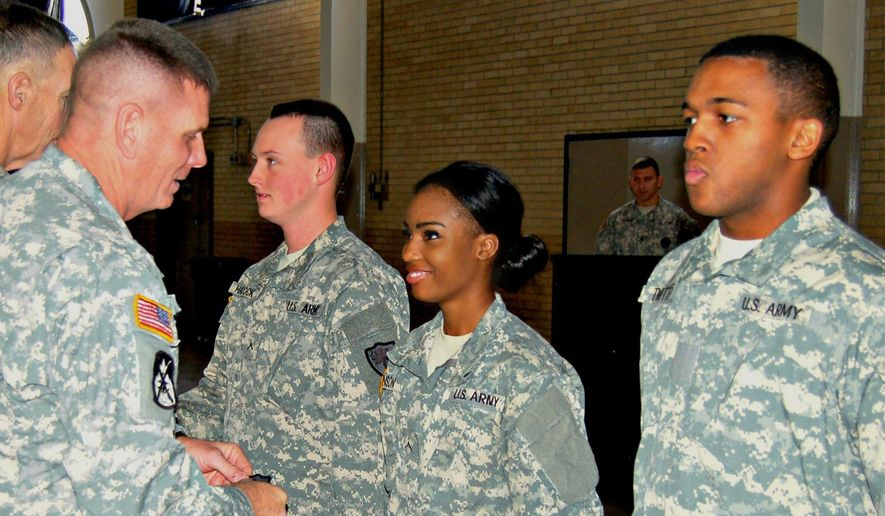 Hundreds of National Guard recruiters are accused of defrauding the government of millions of dollars in the National Guard Recruiting Assistance Program. (Associated Press/File)