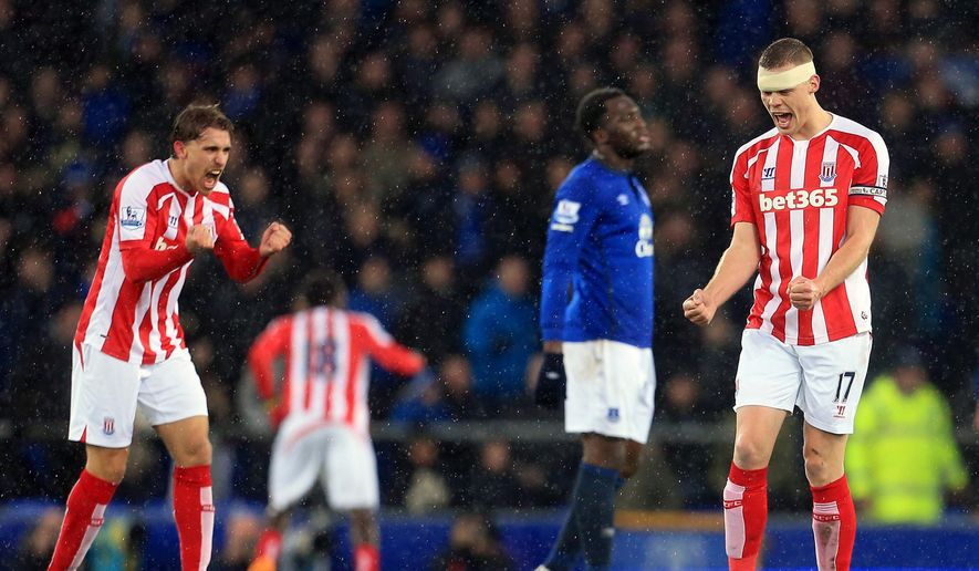 Stoke City's Ryan Shawcross, right, celebrates after Bojan Krkic scores the opening goal of the game, during the English Premier League match between Everton and Stoke City,  at Goodison Park, in Liverpool, England, Friday Dec. 26, 2014. (AP Photo/PA,  Lynne Cameron) UNITED KINGDOM OUT
