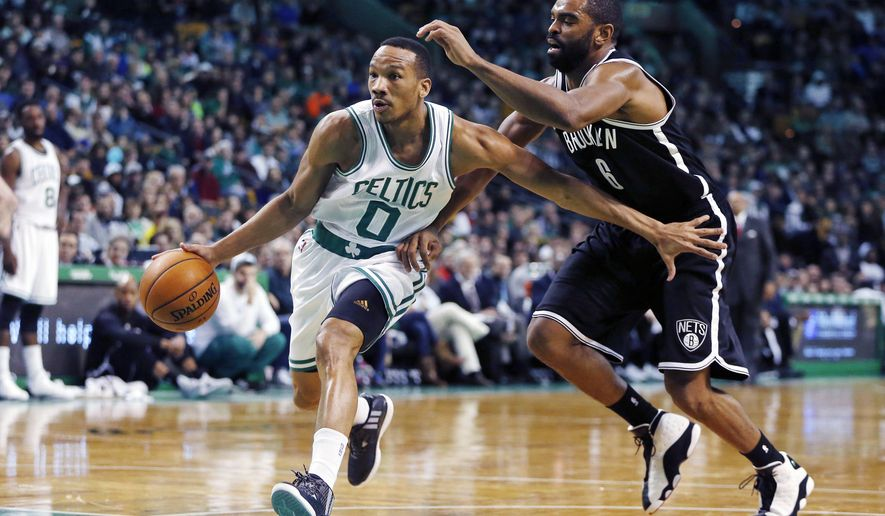 Boston Celtics' Avery Bradley (0) drives past Brooklyn Nets' Alan Anderson (6) during the second quarter of an NBA basketball game in Boston, Friday, Dec. 26, 2014. (AP Photo/Michael Dwyer)