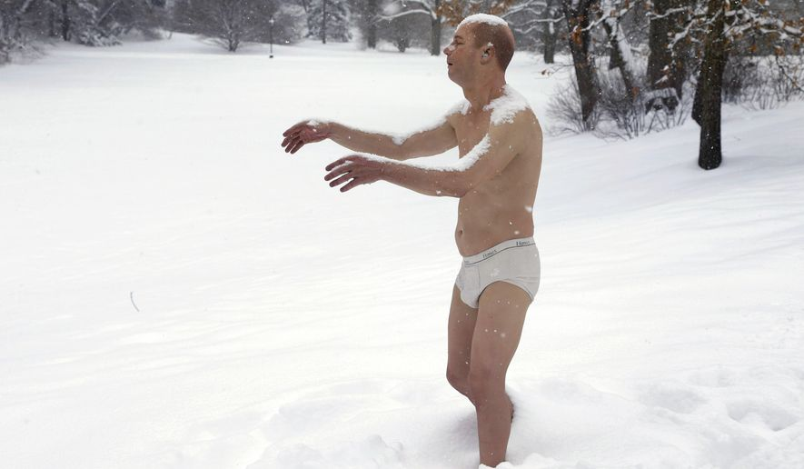 "FOR RELEASE FRIDAY, DECEMBER 26, 2014, AT 12:01 FILE -- In this Feb. 5, 2014 photograph, a statue of a man sleepwalking in his underpants is surrounded by snow in Wellesley, Mass., on the campus of Wellesley College. The sculpture entitled ""Sleepwalker"" was part of an exhibit by sculptor Tony Matelli at the college's Davis Museum. (AP Photo/Steven Senne, File)"
